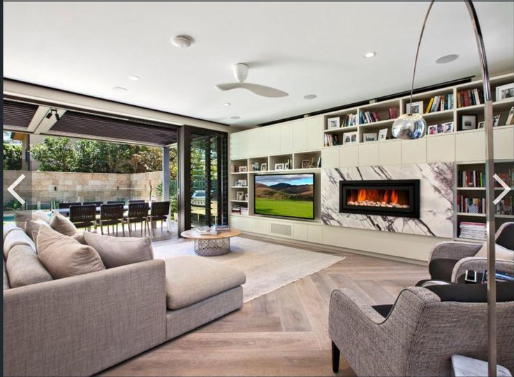 TV stand, gas fireplace, bookshelf and storage space. Our thoughts exactly, however our ceiling is high enough for the gas fireplace to be under the TV