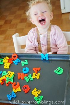 magnets on cookie sheet - 21 Activities for One Year Olds - Baby Play - Wildflower Ramblings
