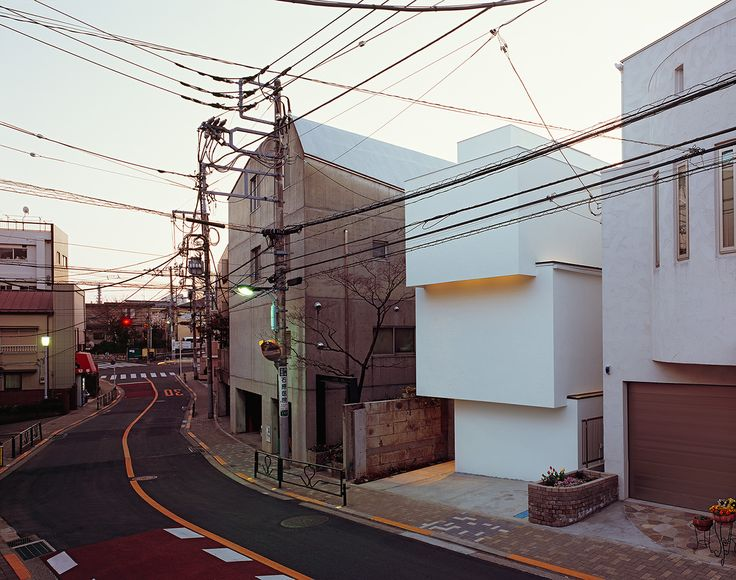 OBI-House is a minimalist house located in Tokyo, Japan, designed by Tetsushi Tominaga. The three-story home is constructed of reinforced concrete and wood. (30)