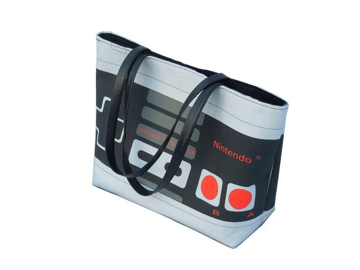 Large Printed Retro NES Nintendo Controller Handbag with Silver Studded Hardware and Snap Closure. $75.00, via Etsy.