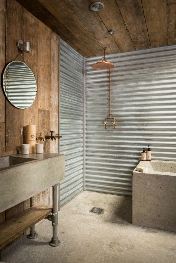 Exposed concrete, distressed metal and wood is the perfect combination for a rustic room and clean copper accents to add a little contrast. Perfect in bathrooms and kitchens.