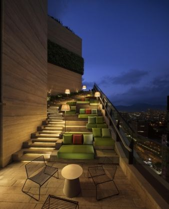 The staircase, where the gardens drop down and the living rooms climb up, becomes an outdoor cinema on Friday nights