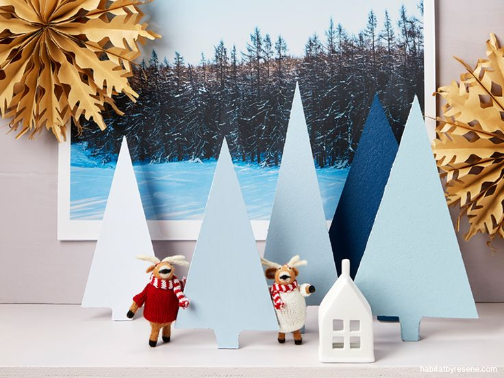 Turn a shelf or mantlepiece into a Christmas diorama. The Christmas trees are made out of cork mats.
