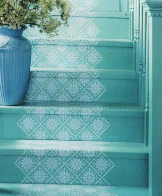 Turquoise stairs with a simple white pattern on top - this is sweet without being too much.