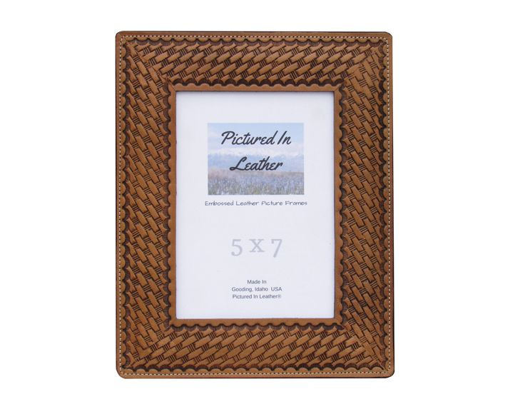 $54  A very lovely leather picture frame in a 5x7 size embossed with a basket weave design. This frame will enhance any picture making it a very special gift!