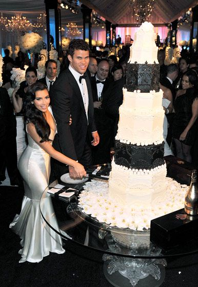 Kim and Kris Humphries' six-foot-tall wedding cake cost an estimated $15-20,000 from Hansen Cakes in L.A. It was reportedly modeled after Prince William and Duchess Kate's royal wedding cake.