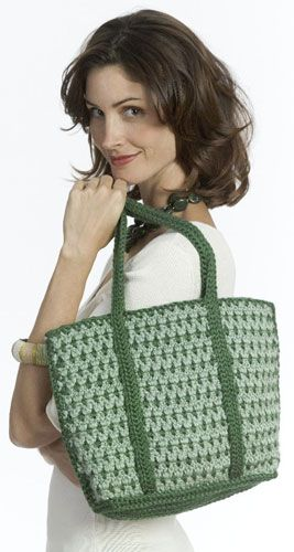 Crochet a lovely tote bag in two complimentary yarn colors with this intermediate bag crochet pattern from Caron International Yarns. The comfortable crochet straps run to the bottom of the tote bag and felt lining completes the pro