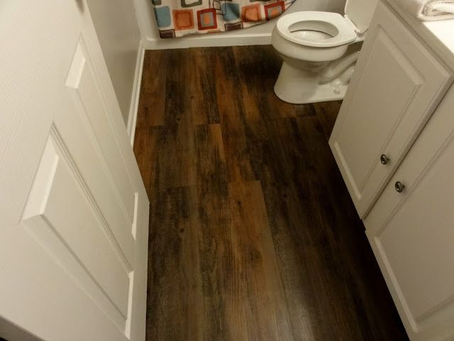 "vinyl peel and stick flooring that looks like real wood. Awesome. Style Selections 6""W x 48""L Cherry Luxury Vinyl Plank... If I couldn't put in real hardwood in my renovated camper, I think this would be second choice (over that vinyl tile for sure)"