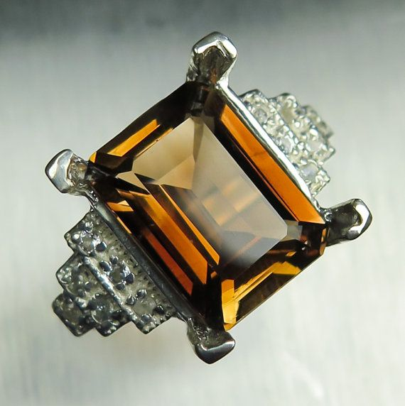 8cts Natural peach brown Imperial topaz emerald cut & by EVGAD