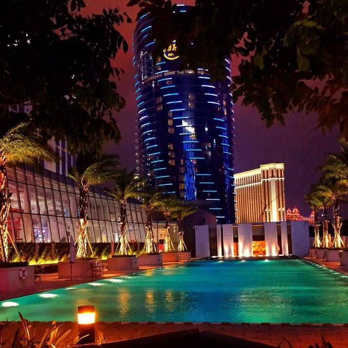 Postcard from Macau. A tranquil hideaway at Grand Hyatt Macau means swimming beneath the palms and the stars.