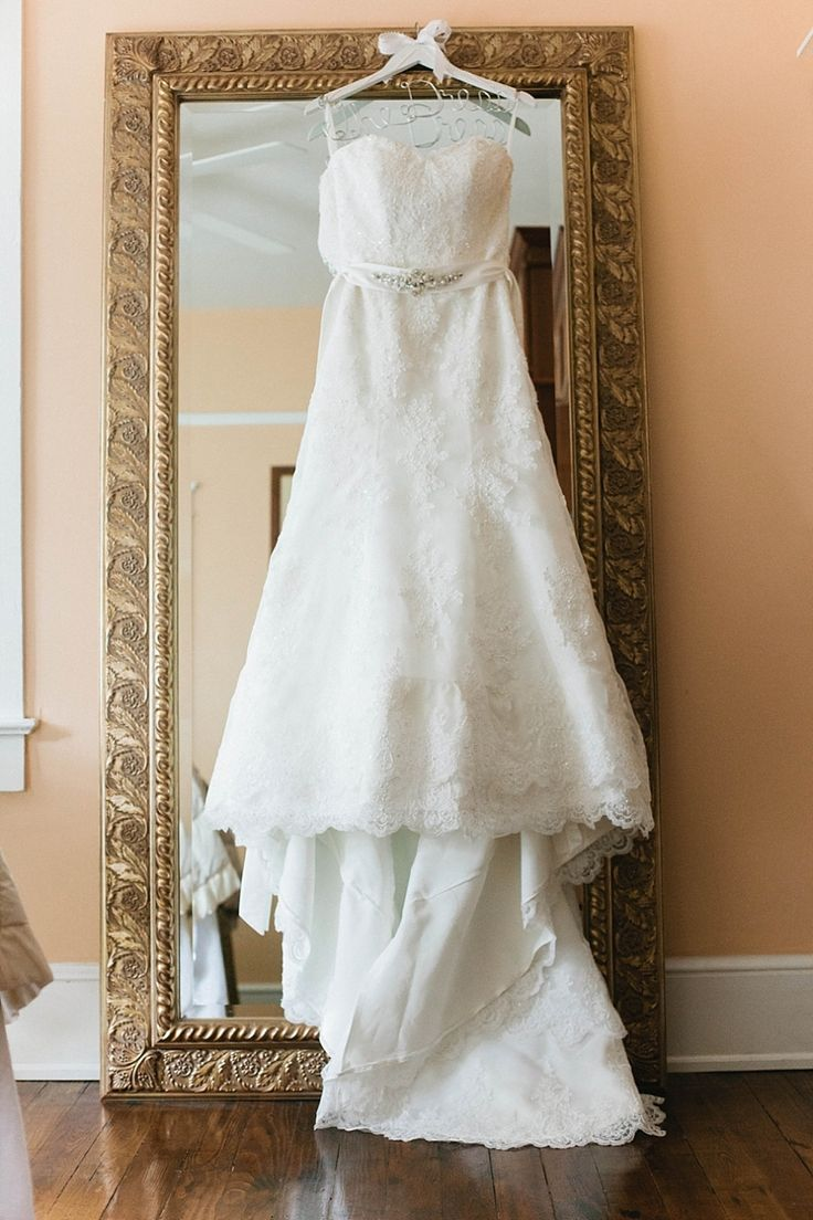 Wedding Dress Hanging Up On A Mirror