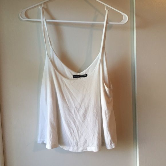 Brandy Melville top Brandy Melville flowy white top. size small. no rips or stains. Brandy Melville Tops Crop Tops