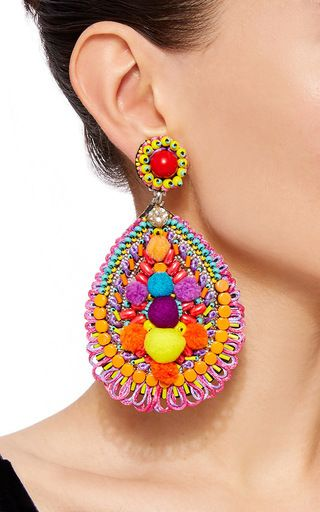 These **Ranjana Khan** earrings feature tear drop shape fully embellished with pom poms, multicolored glass beads, and Swarovski crystals.