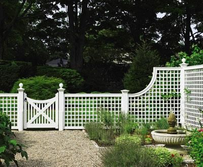 Lattice Fence with Custom Gate - Define your garden area with a fence that that affords privacy and an abundance of charm. The imaginative sloping section flows toward a custom Walpole gate with handsome finials.