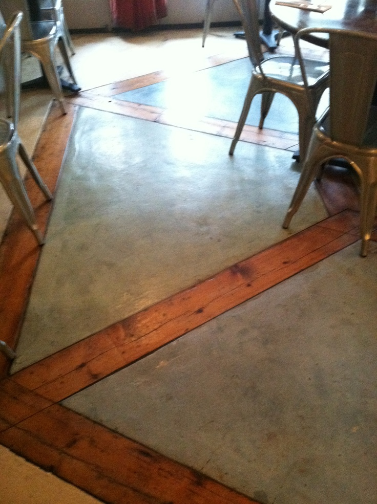 Stained cement floor with reclaimed wood inlay