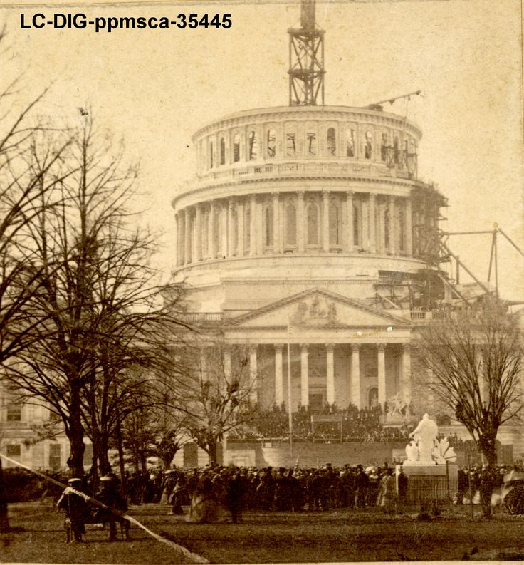 Photograph shows crowds of people viewing Abraham Lincoln's 1861 inauguration at the east front of the U.S. Capitol, with the Capitol dome under construction. https://www.amazon.com/Imperfect-Union-Georgiann-Baldino-ebook/dp/B015N5SC2O