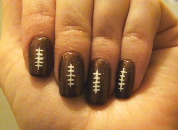 football nails -  I have to get some chocolate OPI so I can do this for my son's next game!  Why didn't I think of it before?