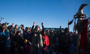 Activists celebrate at Oceti Sakowin Camp on the edge of the Standing Rock Sioux Reservation on December 4, 2016.