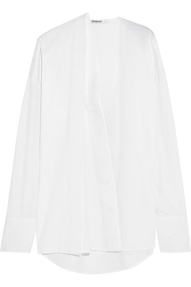 Chalayan's oversized cotton-poplin shirt has deconstructed panels and judo-inspired topstitching. It's finished with extra long sleeves - one of our favorite street style trends at the moment. Keep your look cool and minimal with black pants.