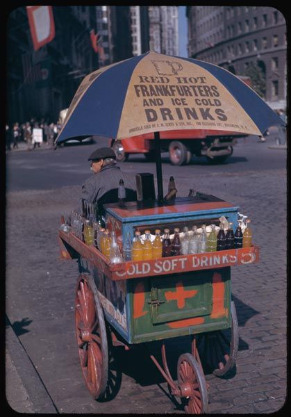 ... portable soft drink stand at Bowling Green, circa 1940s New York ... Kodachrome photo by Charles Weever Cushman, courtesy of Indian University ... for more of Cushman's Kodachrome photos of 1940s New York, see: http://flavorwire.com/198628/kodachrome-photos-of-1940s-new-york-city/?utm_source=facebook_medium=flavorwire_campaign=standard-post