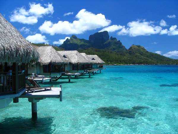 Bora Bora.....thatched roof tiki hut over perfectly serene water, someday....