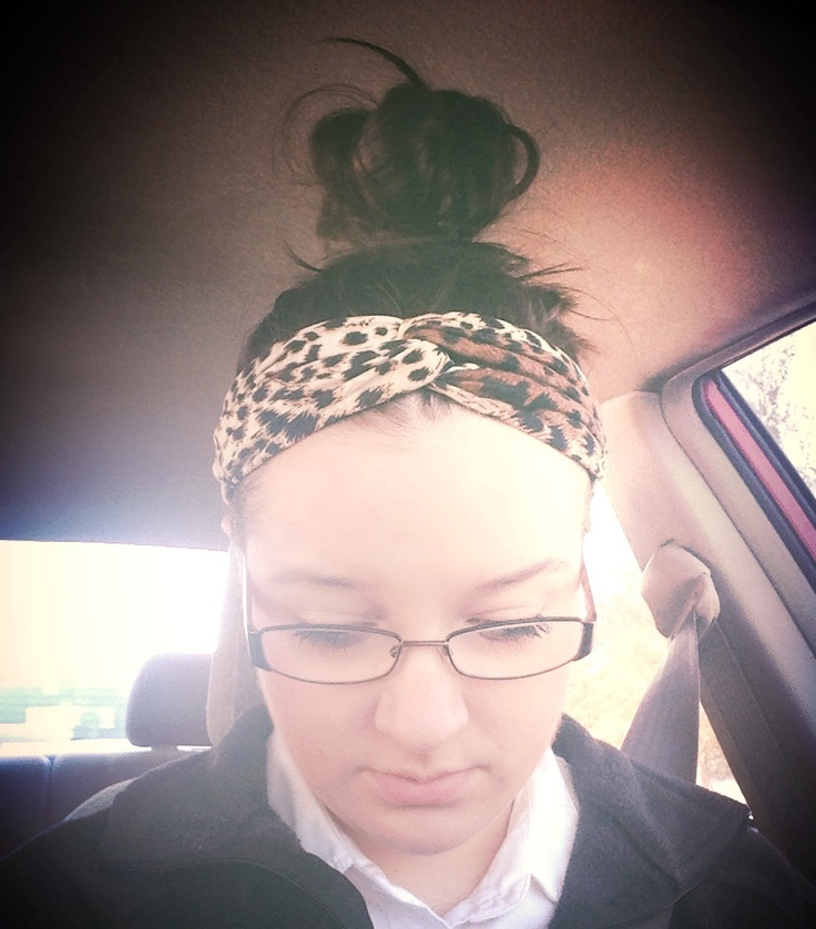 Top knot and knot headband. Super easy hair for work.