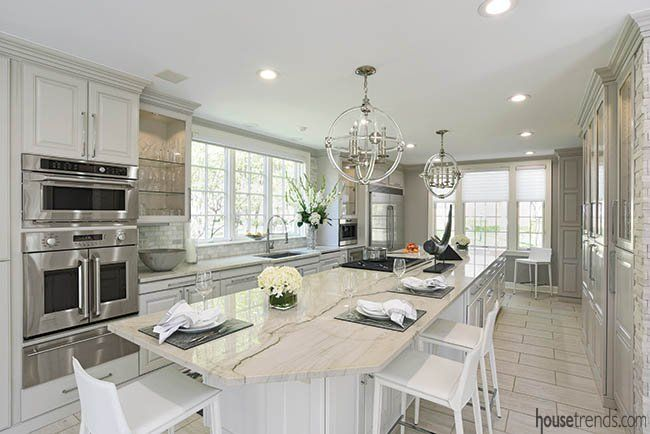 Unbelievable light fixtures take center stage in this kitchen in a Columbus, Ohio house. #housetrends