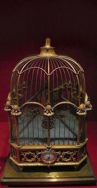 I am always amazed at how many different beautiful bird cages there were in olden times! This one is so beautiful and has a clock on it! They could be used for so many things now..