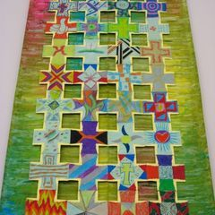 Each person decorates a cross. All the crosses are put together to form one large piece of artwork.