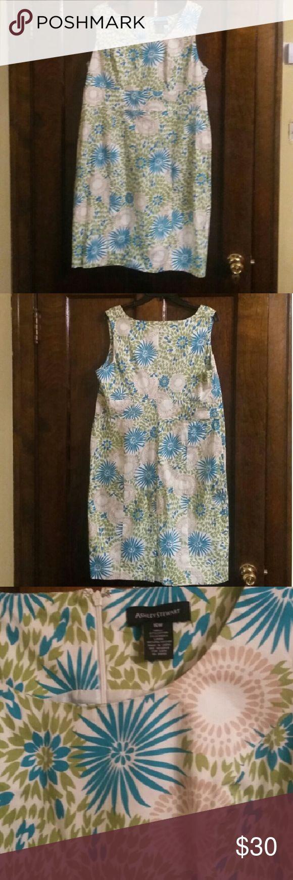 Ashley Stewart dress Very pretty Ashley Stewart dress. It has green beige blue and white in it. It is in great shape. Ashley Stewart Dresses Midi