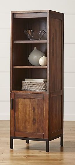 Alone or paired up on either side of the Wyatt media console, this tower showcases the rich warmth of solid sheesham wood enhanced with a rich walnut finish. Adjustable shelves, two open and one behind the closed door, provide ample storage for media, albums or books.
