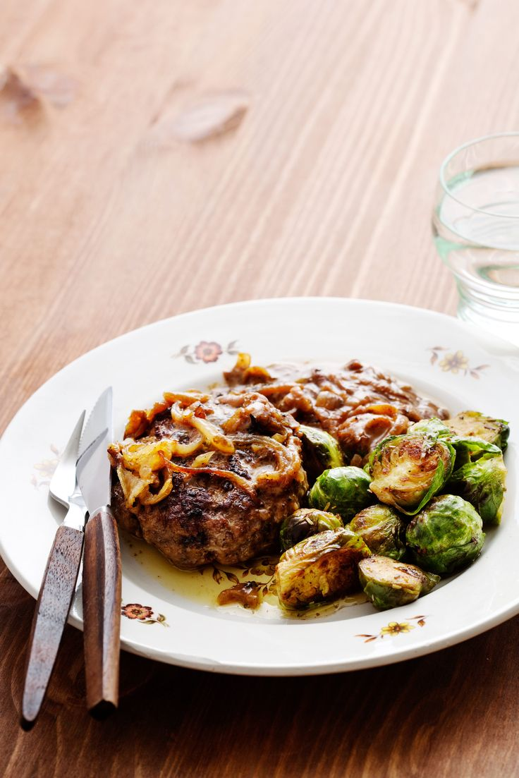 Juicy patties served with creamed onions and Brussels sprouts provide a delicious and affordable dinner. This is a great go-to recipe for busy weeknights!