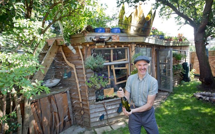 """Eco shed crowned shed of the year 2014 winner - The winners of the Shed of the Year competition, sponsored by Cuprinol, have been announced. An """"eco shed"""" with an allotment on its roof won the overall prize. Designed by Joel Bird from North London, the shed's lights are entirely powered by a solar panel. Picture: Cuprinol"""