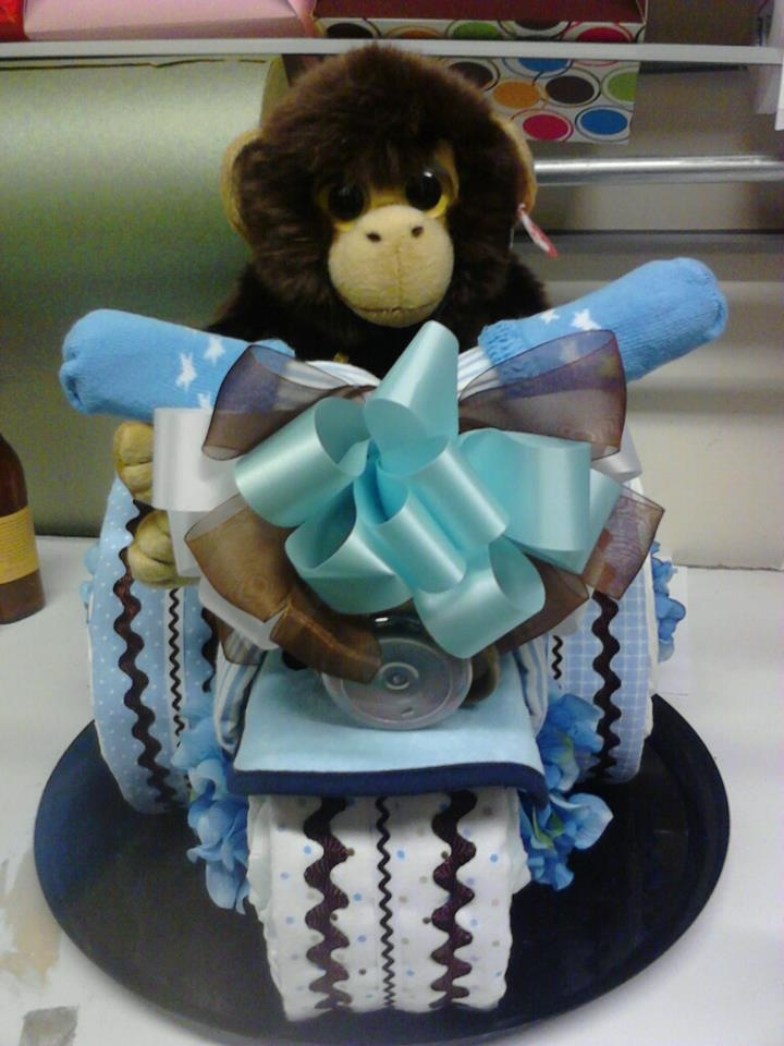DIAPER CAKE - Chocolate and baby blue Monkey, Diaper Tricycle:  This creation includes 5 receiving blankets, 3 bibs, teething ring, bottle, pair of socks, 75 diapers and a plush monkey