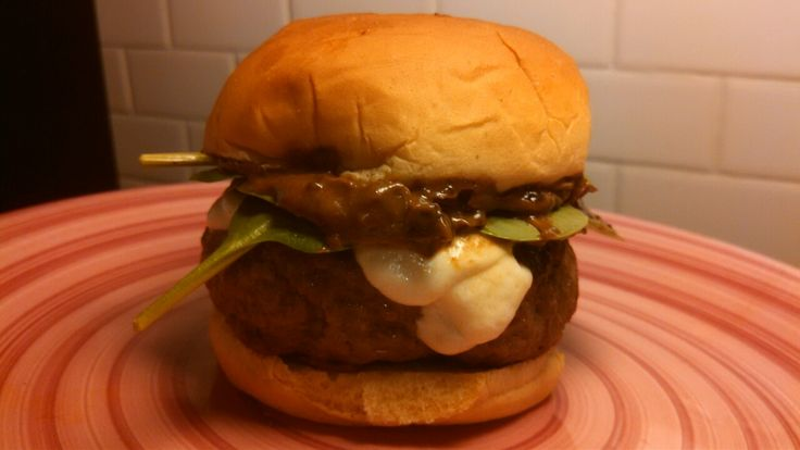 Bet It All On Black Garlic Burger Season 5 Episode 5: Best Burger  An all beef patty topped with fresh mozzarella, spinach, tomato ,homemade black garlic mayo and a dash of sriracha hot sauce.