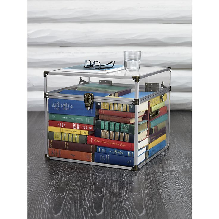 For those with nothing to hide, an acrylic cube can artfully house coffee table books while keeping the surface clear for drinks and knick-knacks.