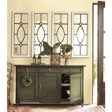 Garden District Mirror : The design was inspired by a beveled glass window we admired in the garden district of New Orleans. Like the original, ours has a rich verdigris finish achieved by hand applying layers