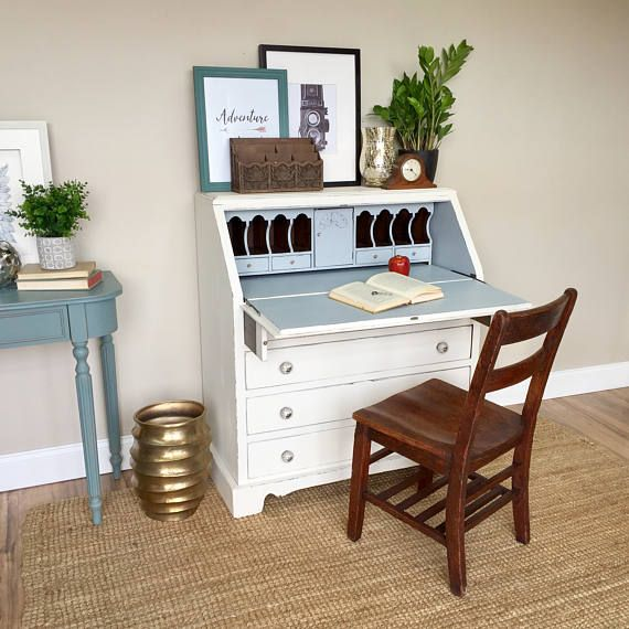 Add some classic vintage style to your beach or country cottage with this compact secretary desk. Perfect to tuck into a small corner or nook in any room. This drop front desk is the perfect solution for saving space in a bedroom or home office. Keep books and supplies hidden when not in use. It will also work as a media center or bar in smaller spaces. It has four drawers for ample storage of books, mail and paperwork. It can be modified by adding a back board to make it into a small…