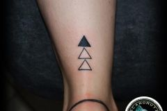 Tattoo triangle is a good suggestion for your small tattoo.