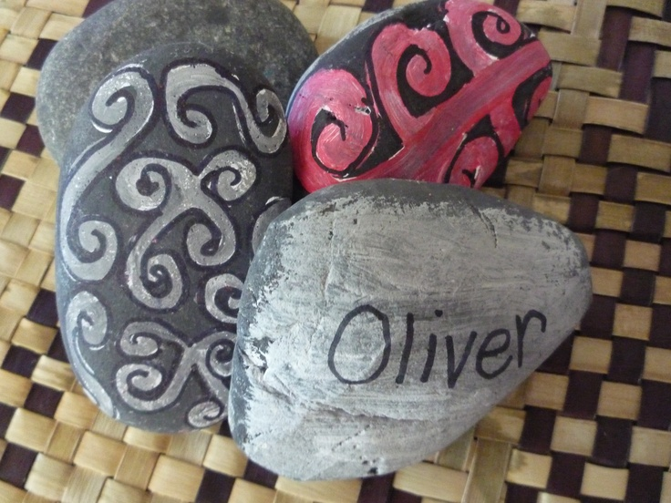 Name stones for the collage area to help tamariki recognise and copy their names. A Maori kōwhaiwhai pattern on the opposite side add interest and will help with early recognition. Ask the children to find their name for you everytime you write their names on to their art work.