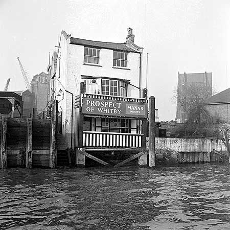An exterior view from the River Thames. The public house was originally built in 1520 and known as the Devil's Tavern through its association with thieves and smugglers. Its name was changed to the Prospect of Whitby in 1777.