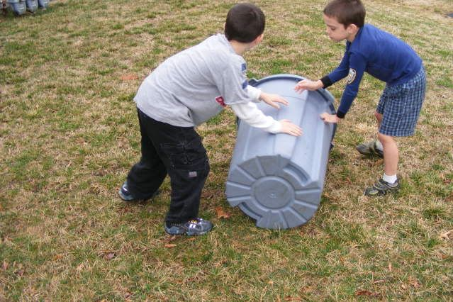 drill small holes in a trash can to make a compost bin... strap the lid in place and have kids roll around so you don't have to turn the soil yourself. genius.