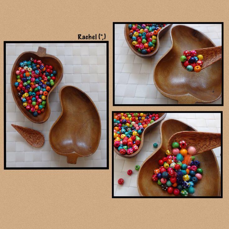 "Spooning beads - fine motor work from Rachel ("",)"