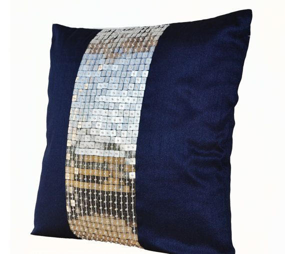 Metallic throw pillow in navy blue and silver color block on art silk with sequin bead detail. This elegant decorative pillow is intricately beaded