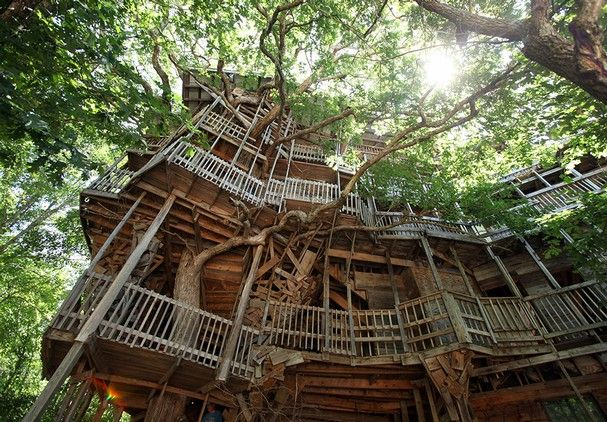 Multiple decks, staircases and balconies wrap around a tree in a treehouse created by Horace Burgess in Crossville Thursday, June 28, 2012. (Photo by Adam Brimer)