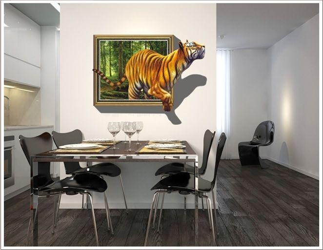 Wall-By-Wall | Muursticker tijger. Denk je er al lang over om iets aan de muur te hangen? Maar vind je niet de juiste muurdecoratie? Laat de tijger in je los met dit spectaculaire schilderij! Prachtige muursticker met 3D effect van een tijger die uit een kader komt met schaduw erbij.
