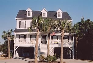 This North Myrtle Beach rental has five bedrooms and five-and-one-half baths. There is room enough for 18 people in this North Myrtle Beach house. This beach house in North Myrtle Beach, SC is on stilts and is quite spacious as it features two levels of living space, plus outdoor balconies and a private swimming pool and sun deck.