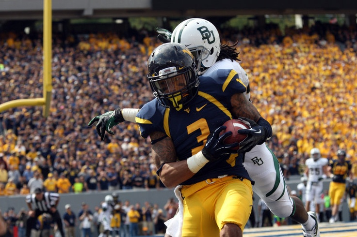 """No. 8 WVU's first football game in the mighty Big12 was against the Baylor Bears, also ranked in the Top-25. And what a game it was. WVU QB Geno Smith threw for 656 yards and 8 touchdowns in a record-setting 70-63 win at a fan """"striped"""" Milan Puskar Stadium. WR Stedman Bailey (pictured) had 13 receptions for 303 yards and 5 touchdowns."""