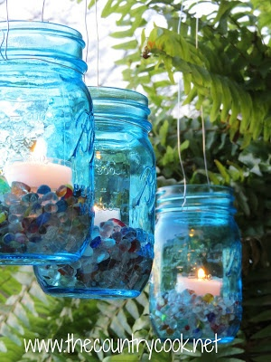 These jars are part of the Ball Heritage Collection. They're already blue!!!!!!! The author of Country Cook makes pretty, summery Mason Jar Lanterns. Great tutorial.