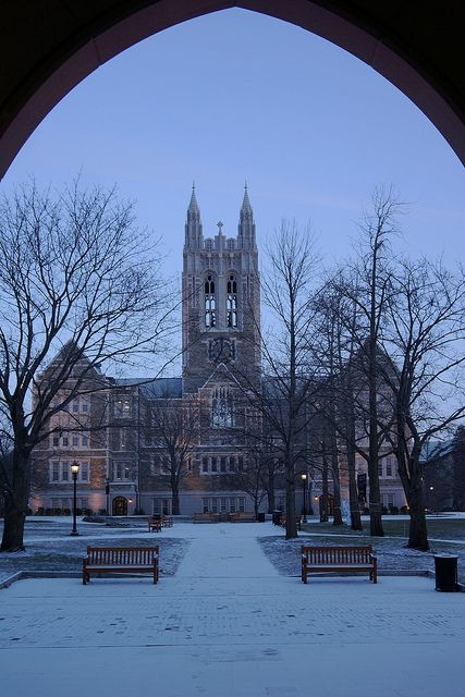View of Gasson Hall beneath arches of Fulton Hall during the wintertime #bostoncollege